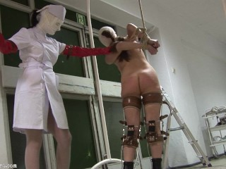 Patient in Leg Braces and Straijacket receives heavy caning punishment