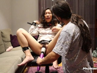 Chinese babe gets tied to a chair and played with until brought to orgasm